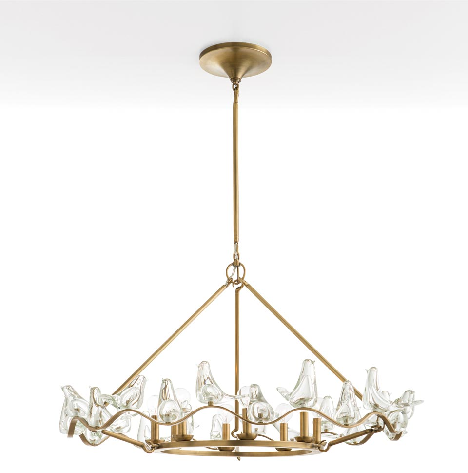 Grand lustre en laiton antique 8 lumières Dove . Arteriors.