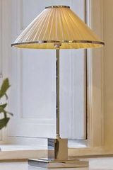 Soho chrome bronze table lamp and ivory silk. Jacques Garcia.