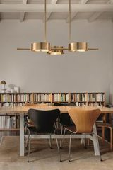 Long golden pendant light 3 lights Sound. Masiero.