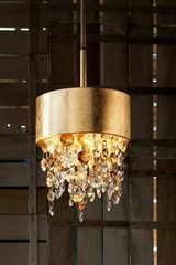Ola pendant in gold-plated metal with gold leaf. Masiero.