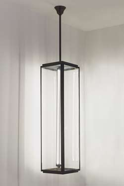 Longue suspension en bronze antique verre clair. Nautic by Tekna.